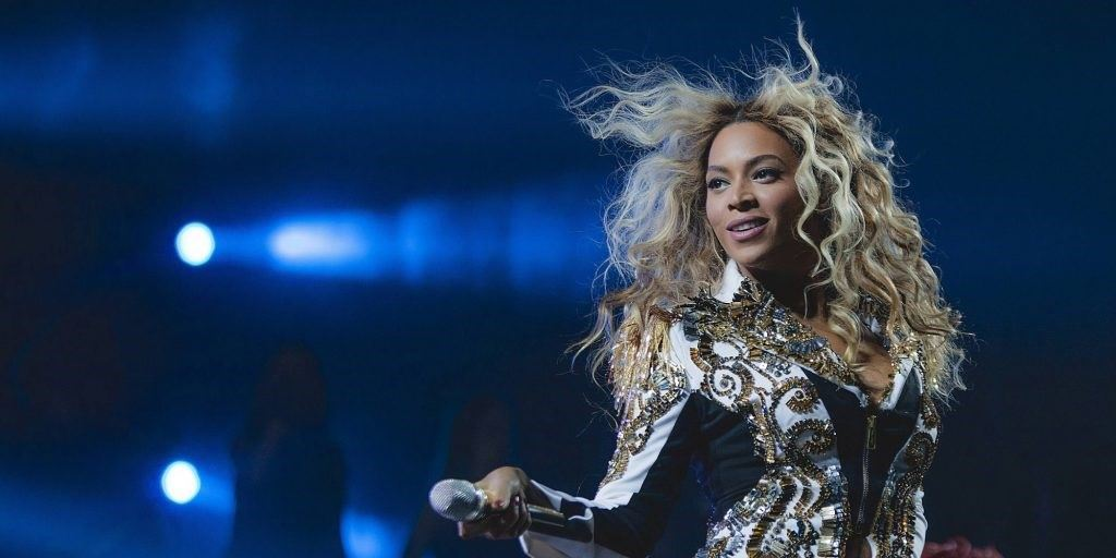 """IMAGE DISTRIBUTED FOR PARKWOOD ENTERTAINMENT - Beyonce performs onstage at her """"Mrs. Carter Show World Tour 2013,"""" on Wednesday, December 19, 2013 at the Barclays Center in Brooklyn, New York. (Photo by Rob Hoffman/Invision for Parkwood Entertainment/AP Images)"""